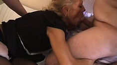 Gorgeous French maid does her job as she cleans a pair of cocks